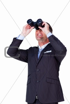 Attractive businessman looking up with binoculars