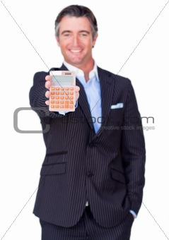 Attractive businessman holding a calculator