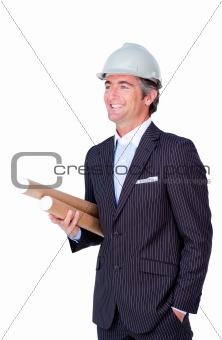 Smiling architect wearing a hardhat