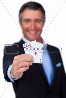Smiling businessman holding all the aces