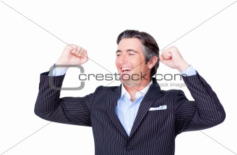 Attractive businessman punching the air celebrating a victory