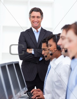 Self-assured businessman presenting a call center