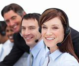Portrait of a businesswoman and her team working in a call cente