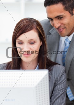 Two charismatic colleagues working at a computer
