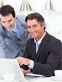 Two businessmen working at a computer