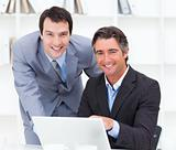 Close-up of two businessmen working at a computer