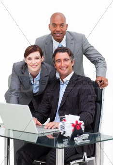 Self-assured business team working at a computer