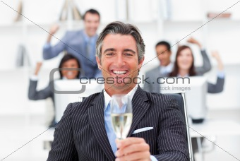 Prosperous manager and his team drinking champagne