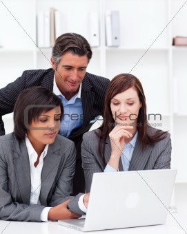Concentrated business partners working at a computer