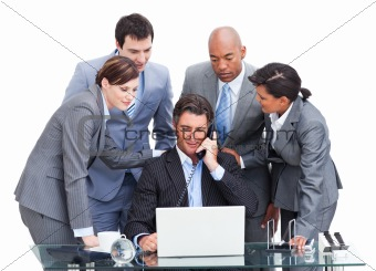 Assertive manager on phone and his team