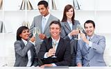 Positive business people toasting with Champagne