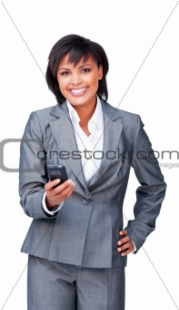 Attractive businesswoman smiling at the camera while sending a t