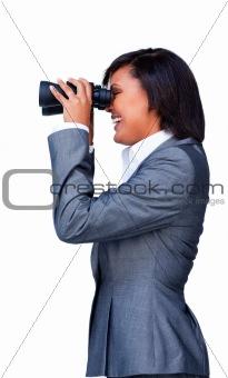 Attractive businesswoman looking through Binoculars