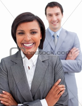 Beautiful businesswoman posing in front of her colleague