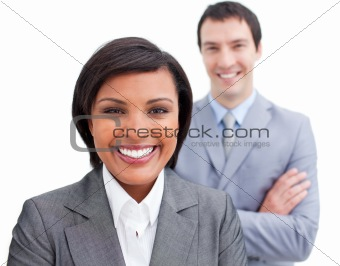 Radiant businesswoman posing in front of her colleague