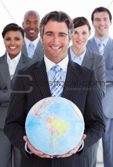 Ambitious business team showing a terrestrial globe