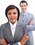 Ethnic businesswoman posing in front of her colleague