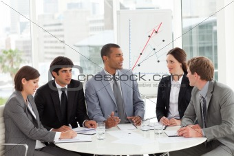Business group studying sales report