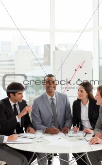 Afro-american manager in a meeting with his team
