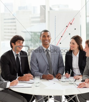 Attractive manager in a meeting with his team