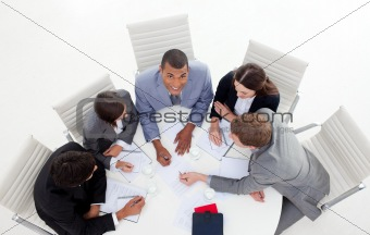 High angle of a business group sitting around a conference