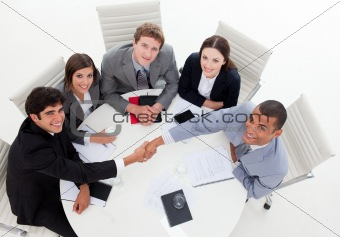 A diverse business group closing a deal