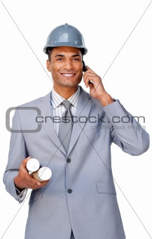 Smiling attractive architect wearing a hardhat on phone