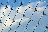 Metal wire fence against sky - slight side view