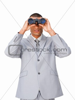 Attractive Ethnic businessman using binoculars
