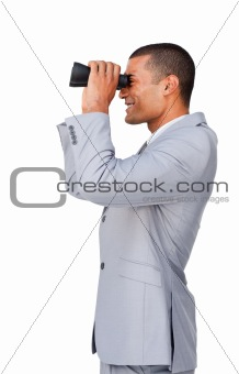 Smiling Attractive businessman looking through binoculars