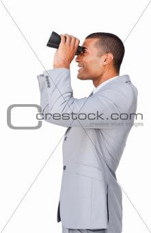 Young afro-american businessman using binoculars