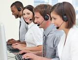 Positive business partners with headset on working in a call center