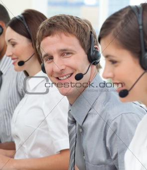 Blond businessman smiling at the camera