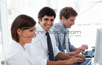 Positive business people working at computers