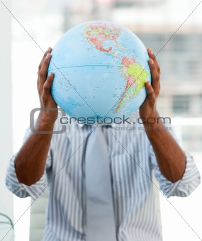 Afro-american businessman holding a terrestrial globe