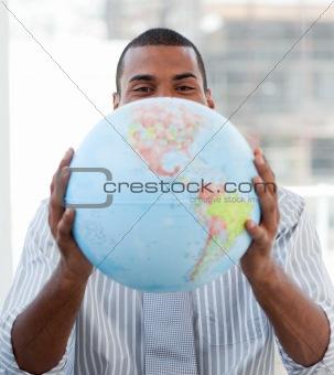 Fortunate businessman holding a terrestrial globe