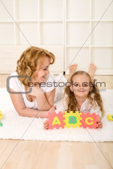 Little girl learning the alphabet