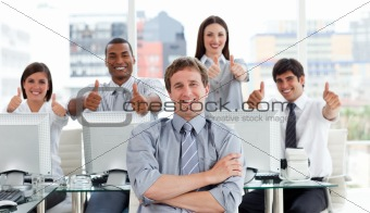 Positive business people with thumbs up