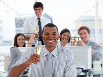 Lucky business team drinking champagne