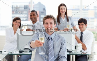 Fortunate business team drinking champagne