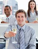 Close-up of successful business team drinking champagne