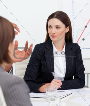 Portrait of attractive businesswoman talking with her team