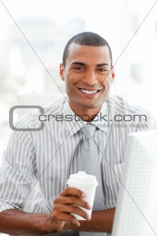 Afro-american businessman drinking a coffee