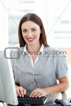 Attractive businesswoman at a computer