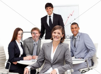 Charming businesswoman sitting in front of her team