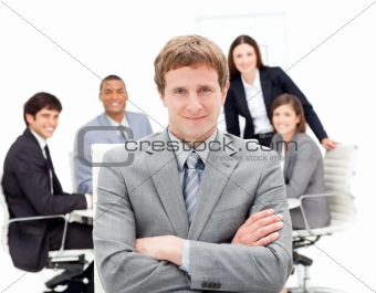 Charming manager with folded arms in front on his team