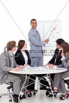 Smiling businessman reporting sales figures