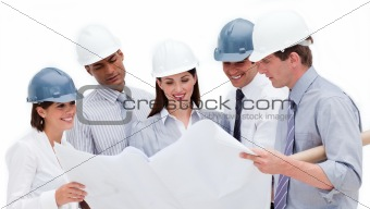 Smiling architects studying a blueprint