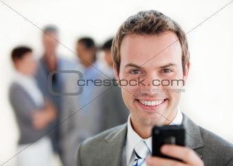 Charming businessman sending a text