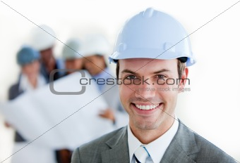 Smiling arhitect with a hardhat